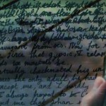 video - writing travel letters on rough sea